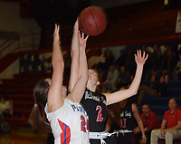 RICK PECK/SPECIAL TO MCDONALD COUNTY PRESS<br /> McDonald County's Addy Mick goes over East Newton's Robin Hussong for a rebound during the Lady Mustangs' 35-32 win on Jan. 17 at East Newton High School.