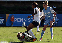 SAN DIEGO, CA - DECEMBER 02, 2012:  Adelaide Gay (33) of the University of North Carolina saves at the feet of Maya Hayes (5) of Penn State University during the NCAA 2012 women's college championship match, at Torero Stadium, in San Diego, CA, on Sunday, December 02 2012. Carolina won 4-1.