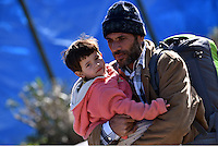 Pictured: A migrant father and his young son at the refugee camp Tuesday 23 February 2016<br /> Re: Migrants at a refugee camp in the Schisto area of Athens, Greece.