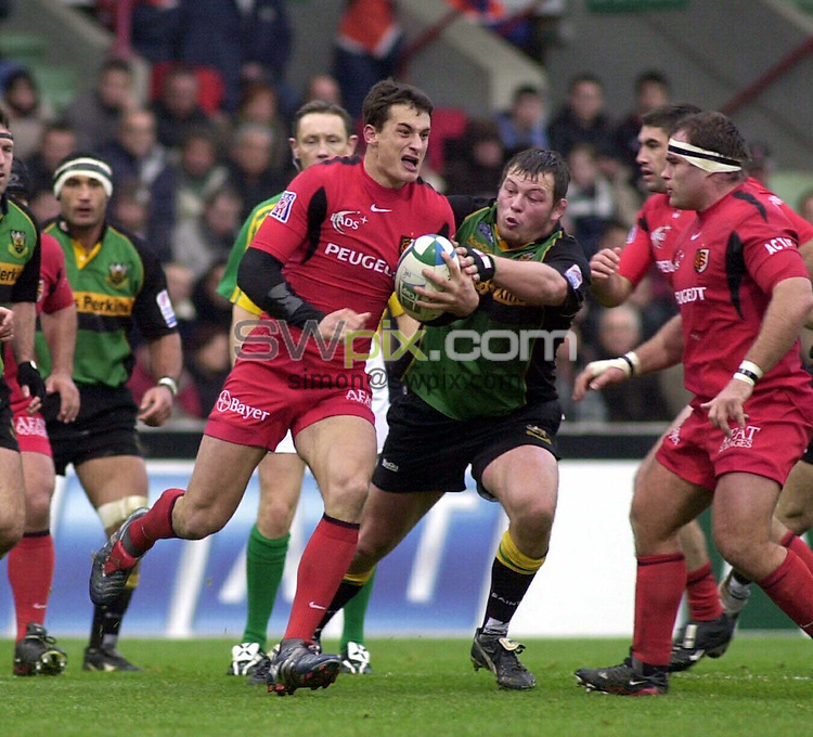PIX: Rugby. Heineken Cup. Preview of Quarter-Final, Toulouse-Northampton, The Stadium, Toulouse, 3rd April 2005...COPYRIGHT PICTURE>> SIMON WILKINSON>>0870 092 0092>>..Northampton have had some tough games in Toulouse in the past. Here, Steve Thompson tackles Yannick Jauzion.