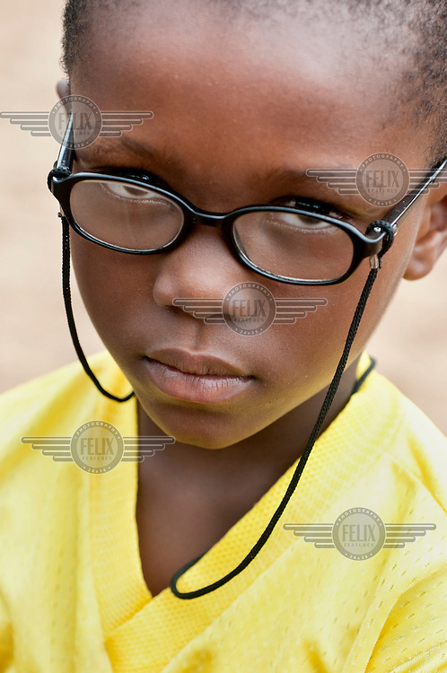 A schoolboy wearing a pair of glasses at the North Ridge Model Kindergarden.