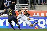 30 September 2015: Kansas City's Krisztian Nemeth (HUN) (right) steps on the ball and falls down in front of Philadelphia's Michael Lahoud (13). The Philadelphia Union hosted Sporting Kansas City at PPL Park in Chester, Pennsylvania in the 2015 Lamar Hunt United States Open Cup Final. The game ended in a 1-1 tie after extra time. Sporting Kansas City won the Championship by winning the penalty kick shootout 7-6.