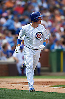 Chicago Cubs second baseman Chris Coghlan (8) runs to first during a game against the Milwaukee Brewers on August 13, 2015 at Wrigley Field in Chicago, Illinois.  Chicago defeated Milwaukee 9-2.  (Mike Janes/Four Seam Images)