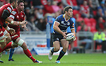 John Cooney looks to pass the ball out wide..RaboDirect Pro12.Scarlets v Leinster.Parc y Scarlets.01.09.12.©Steve Pope