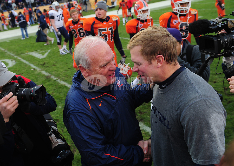 Dec. 18, 2010; Albuquerque, NM, USA; BYU Cougars head coach Bronco Mendenhall (right) is congratulated by UTEP Miners head coach Mike Price following the 2010 New Mexico Bowl at University Stadium. BYU defeated UTEP 52-24. Mandatory Credit: Mark J. Rebilas-