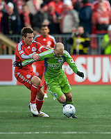 Freddie Ljungberg (10) of the Seattle Sounders FC and Jim Brennan ( 11) of Toronto FC in MLS action at BMO Field on April 4, 2009.Seattle won 2-0.