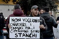Roma, 21 Dicembre 2016<br /> Cittadini con cartelli contro la sindaca Virginia Raggi durante la Manifestazione a Tor Sapienza contro il degrado , i roghi tossici , per la chiusura del campo Rom di Via Salviati