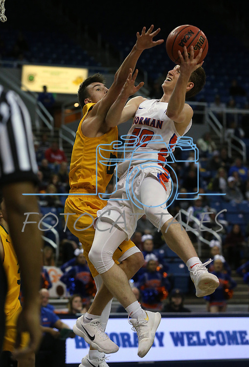 Bishop Gorman's Noah Taitz shoots over a Bishop Manogue defender in the 4A NIAA state basketball championship game in Reno, Nev., on Friday, Feb. 23, 2018. Gorman won 62-41. Cathleen Allison/Las Vegas Review-Journal