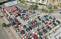 BOGOTA, COLOMBIA - March 23:  Aerial view of a car lot next to a billboard that reads 'on Covid-19, if you take care of your self, we all take care of ourselves'  in Bogota on March 23, 2020. Colombian government declared a nationwide quarantine from March 24 until April 13 to prevent the spread of the Coronavirus that has 306 confirmed cases in the country at the moment. (Photo by Daniel Munoz/VIEWpress via Getty Images)