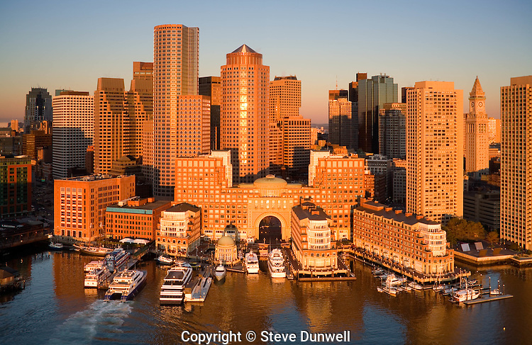 Skyline at sunrise, from harbor, aerial, Boston, MA Rowes Wharf