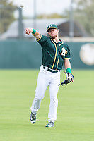 Oakland Athletics third baseman Nick Osborne (7) warms up before an exhibition game against Team Italy at Lew Wolff Training Complex on October 3, 2018 in Mesa, Arizona. (Zachary Lucy/Four Seam Images)