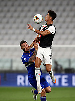 Calcio, Serie A: Juventus - Sampdoria, Turin, Allianz Stadium, July 26, 2020.<br /> Juventus' Cristiano Ronaldo (r) in action with Sampdoria Lorenzo Tonelli (l) during the Italian Serie A football match between Juventus and - Sampdoria at the Allianz stadium in Turin, July 26, 2020.<br /> UPDATE IMAGES PRESS/Isabella Bonotto