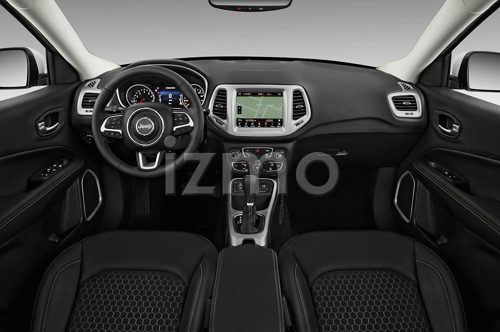 Stock photo of straight dashboard view of 2017 JEEP Compass Latitude 5 Door SUV Dashboard