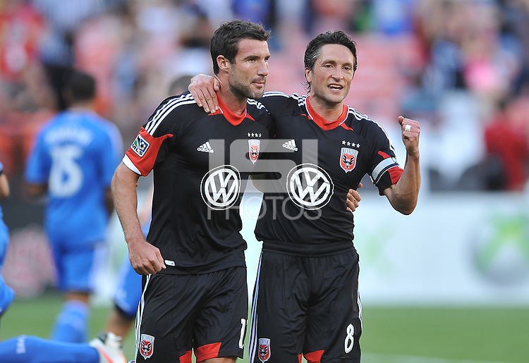 Chris Pontius (13) of D.C. United celebrates with teammate John Thorrington (8) his score from a penalty kick.  D.C. United defeated the San Jose Earthquakes 1-0, at RFK Stadium, Saturday June 22 , 2013.