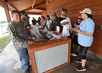 NWA Democrat-Gazette/FLIP PUTTHOFF <br /> Ashley Matsumura (right) with the Rogers-Lowell Area Chamber of Commerce records information from anglers Saturday May 5 2018 during weigh-in at the buddy bass tournament.