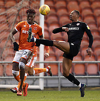 Barnsley's Ethan Pinnock clears under pressure from Blackpool's Armand Gnanduillet<br /> <br /> Photographer Rich Linley/CameraSport<br /> <br /> The EFL Sky Bet League One - Blackpool v Barnsley - Saturday 22nd December 2018 - Bloomfield Road - Blackpool<br /> <br /> World Copyright &copy; 2018 CameraSport. All rights reserved. 43 Linden Ave. Countesthorpe. Leicester. England. LE8 5PG - Tel: +44 (0) 116 277 4147 - admin@camerasport.com - www.camerasport.com