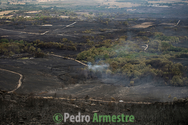 A general view shows burnt fields and forests a day after a wildfire in Cualedro, near Ourense on August 31, 2015. A fire broke out on August 30, 2015 around noon in the Cualedro town in Galicia, northwest Spain, affecting at least 3,180 hectares of forest, as seven fires continued to burn in Spain, three in Galicia, one in Cantabria, one in Castile and Leon, one in Catalonia and Extremadura. © Pedro ARMESTRE