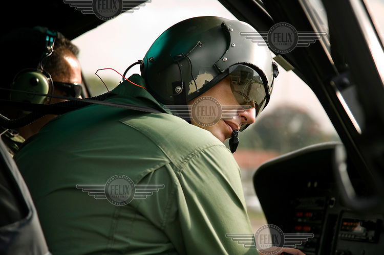 Major Gambaroni arrives at the Military Police's hangar located inside Campo de Marte airport in central Sao Paulo.