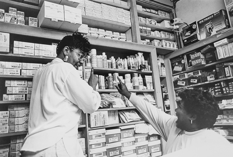 Tonya Boyd and Tabatha Strkkland working at Grubbs Pharmacy, in November 1992. (Photo by Maureen Keating/CQ Roll Call via Getty Images)