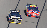Sept. 28, 2008; Kansas City, KS, USA; Nascar Sprint Cup Series driver Mark Martin (8) races alongside Jeff Gordon (24) during the Camping World RV 400 at Kansas Speedway. Mandatory Credit: Mark J. Rebilas-