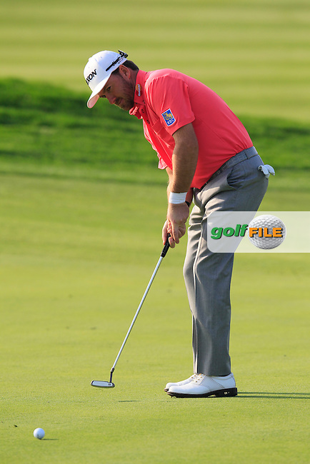 Graeme McDowell (NIR) putts on the 15th green during Sunday's Final Round of the 2014 BMW Masters held at Lake Malaren, Shanghai, China. 2nd November 2014.<br /> Picture: Eoin Clarke www.golffile.ie