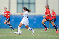 2 October 2011:  FIU's Kelly Ann Hutchinson (12) moves the ball while being pursued by South Alabama's Kristyn Thacker (6) in the first half as the FIU Golden Panthers defeated the University of South Alabama Jaguars, 2-0, at University Park Stadium in Miami, Florida.