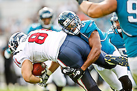 November 27, 2011:   Jacksonville Jaguars cornerback William Middleton (29) tackles Houston Texans tight end Owen Daniels (81) for a loss during second half action between the Jacksonville Jaguars and the Houston Texans played at EverBank Field in Jacksonville, Florida.  Houston defeated Jacksonville 20-13.........