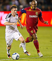 CARSON, CA - November 6, 2011: LA Galaxy forward Robbie Keane (14) and Real Salt Lake defender Jamison Olave (4) during the match between LA Galaxy and Real Salt Lake at the Home Depot Center in Carson, California. Final score LA Galaxy 3, Real Salt Lake 1.