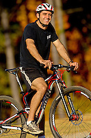 A man (model) enjoys mountain biking at the US National Whitewater Center in Charlotte, NC. The USNWC, an ultimate adventure playground for outdoor enthusiasts, offers both water and land sports.