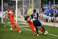 Kansas City, MO - Saturday May 07, 2016: Houston Dash defender Allysha Chapman (15) defends against FC Kansas City defender Brittany Taylor (13) during a regular season National Women's Soccer League (NWSL) match at Swope Soccer Village. Houston won 2-1.