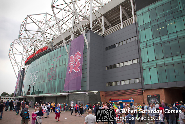 Uruguay 2 United Arab Emirates 1, Great Britain 1 Senegal 1, 26/07/2012. Old Trafford, Olympic Games. Spectators mingle outside Manchester United's Old Trafford stadium prior to the Men's Olympic Football tournament matches at the venue. The double header of matches resulted in Uruguay defeating the United Arab Emirates by 2-1 while Great Britain and Senegal drew 1-1. Over 72,000 spectators attended the two Group A matches. Photo by Colin McPherson.
