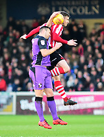 Lincoln City's Michael O'Connor vies for possession with Port Vale's Antony Kay<br /> <br /> Photographer Andrew Vaughan/CameraSport<br /> <br /> The EFL Sky Bet League Two - Lincoln City v Port Vale - Tuesday 1st January 2019 - Sincil Bank - Lincoln<br /> <br /> World Copyright © 2019 CameraSport. All rights reserved. 43 Linden Ave. Countesthorpe. Leicester. England. LE8 5PG - Tel: +44 (0) 116 277 4147 - admin@camerasport.com - www.camerasport.com