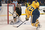 March 26,  2011                     Colorado goalie Joe Howe (31) reaches over to deflect a close shot on goal in the first period.  At right is Michigan forward Carl Hagelin (12). The University of Michigan was leading Colorado College 2-0 after the first period in the championship game of the NCAA Division 1 Men's West Regional Hockey Tournament, on Saturday March 26, 2011 at the Scottrade Center in downtown St. Louis.