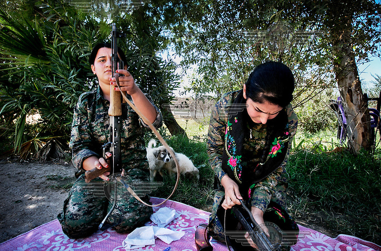 Female soldiers, from the YPJ (Women's Protection Unit), maintain their rifles. The YPJ is a Kurdish female militia fighting the Islamic State and Jabhat al-Nusra in the primarily-Kurdish north. Around 35 percent of the Democratic Union of Kurdistan (PYD)-controlled People's Defense Units (YPG) fighters in Syria are women.