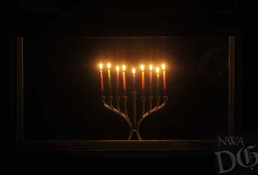 "Photo Illustration  NWA Democrat-Gazette/MICHAEL WOODS • After the menorah is lit on Hanukkah, the 8-day Jewish festival of light, it is traditionally placed in the window for the world to see.  Hanukkah celebrates religious freedom and the triumph of light over darkness. Hanukkah means ""dedication"" and refers to the rededication of the Holy Temple in Jerusalem at the end of the war.  Hanukkah is observed for eight nights and days, starting on the 25th day of Kislev according to the Hebrew calendar."
