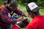 A migrant grooms another one's hair in Lakaxita. Irun (Basque Country). August 30, 2018. Lakaxita is a self-managed socio-cultural space located in an occupied house, where volunteers have created a hosting network for migrants in transit who have already completed the 5-day period that can remain in public resources. This group of volunteers is avoiding a serious humanitarian problem Irún, the Basque municipality on the border with Hendaye. As the number of migrants arriving on the coasts of southern Spain incresead, more and more migrants are heading north to the border city of Irun. (Gari Garaialde / Bostok Photo)