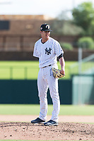 Glendale Desert Dogs relief pitcher Hobie Harris (41), of the New York Yankees organization, looks in for the sign during an Arizona Fall League game against the Scottsdale Scorpions at Camelback Ranch on October 16, 2018 in Glendale, Arizona. Scottsdale defeated Glendale 6-1. (Zachary Lucy/Four Seam Images)