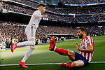 Federico Valverde of Real Madrid and Felipe Augusto de Almeida of Atletico de Madrid