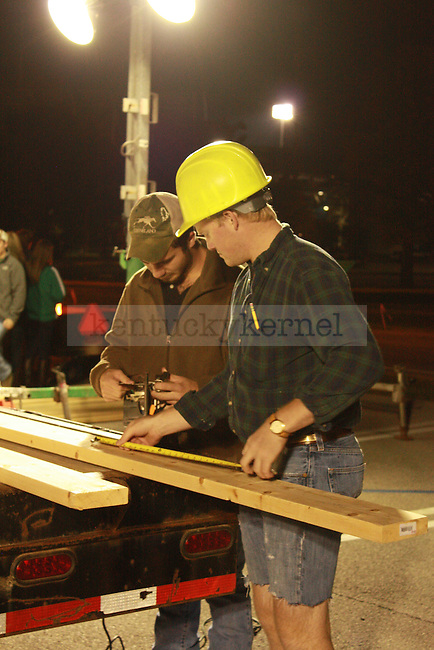 Civil engineering senior Taylor Menard, left, and biology junior Wil Jackson, right, work on their float at the Homecoming Float Build at Commonwealth Stadium in Lexington, Ky., on Monday, October 15, 2012. Photo by Corey Ferguson | Staff