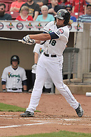 Cedar Rapids Kernels center fielder Chris Cavaness (18) swings at a pitch during a game against the Beloit Snappers at Veterans Memorial Stadium on April 9, 2017 in Cedar Rapids, Iowa.  The Kernels won 6-1.  (Dennis Hubbard/Four Seam Images)