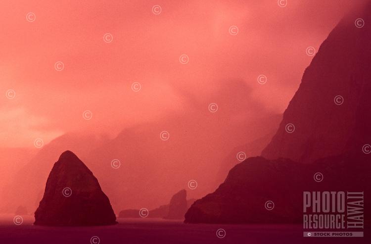 Misty view of the north coastline off the Kalaupapa peninsula, with Okala Island (aka Musubi Rock) on the left