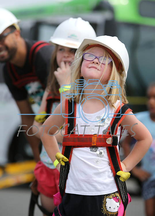 "Elodie Pavlov, 5, waits her turn to ride in an NV Energy aerial bucket at the Touch-a-Truck event at the Carson City Library in Carson City, Nev., on Saturday, Aug. 5, 2017. More than 600 people participated in this year's Summer Learning Challenge, themed ""Build a Better Community"".<br /> Photo by Cathleen Allison/Nevada Photo Source"