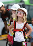 Elodie Pavlov, 5, waits her turn to ride in an NV Energy aerial bucket at the Touch-a-Truck event at the Carson City Library in Carson City, Nev., on Saturday, Aug. 5, 2017. More than 600 people participated in this year&rsquo;s Summer Learning Challenge, themed &ldquo;Build a Better Community&rdquo;.<br /> Photo by Cathleen Allison/Nevada Photo Source