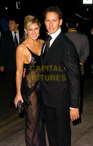 HOFIT GOLAN & BRENDAN COLE.The Gina Shoes 50th Anniversary Party, Dorchester Hotel, London, UK..September 19th, 2006.Ref: CAN.half length black dress sheer see through thru clutch purse suit.www.capitalpictures.com.sales@capitalpictures.com.©Can Nguyen/Capital Pictures