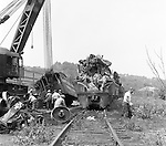 Corliss PA - View of a crane and workers cleaning up an accident site near the train station at Corliss Pennsylvania.  The assignment was for the PA Railroad due to a train derailment near the station - 1964.  Brady Stewart Studio was a contract photography studio for the railroad from 1955 through 1965.
