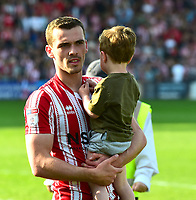 Lincoln City's Harry Toffolo celebrates securing the League 2 Title<br /> <br /> Photographer Andrew Vaughan/CameraSport<br /> <br /> The EFL Sky Bet League Two - Lincoln City v Tranmere Rovers - Monday 22nd April 2019 - Sincil Bank - Lincoln<br /> <br /> World Copyright © 2019 CameraSport. All rights reserved. 43 Linden Ave. Countesthorpe. Leicester. England. LE8 5PG - Tel: +44 (0) 116 277 4147 - admin@camerasport.com - www.camerasport.com