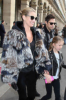 Kate Moss, her husband Jamie Hince and their daughter leaving the Louis Vuitton fashion show - Paris