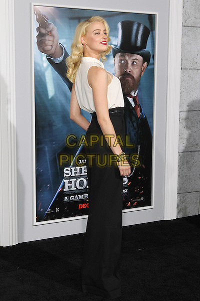 Amber Heard.The World Premiere of 'Sherlock Holmes: A Game of Shadows' held at The Village Theatre in Brentwood, California, USA..December 6th, 2011.full length white sleeveless shirt black trousers gold bracelet side.CAP/CEL .©CelPh/Capital Pictures.