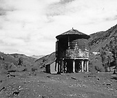 North-facing, post-abandonment view of the RGS Rico water tank and section car shed.<br /> RGS  Rico, CO