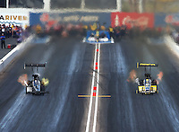Feb 22, 2015; Chandler, AZ, USA; NHRA top fuel driver Richie Crampton (right) races alongside Shawn Langdon during the Carquest Nationals at Wild Horse Pass Motorsports Park. Mandatory Credit: Mark J. Rebilas-